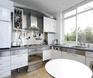 photo of white kitchen and furniture wine rack