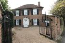Detached house in Cheam Common Road...