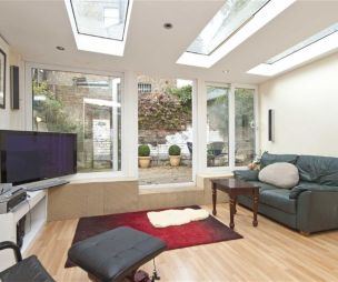photo of airy bright light beige white with skylights