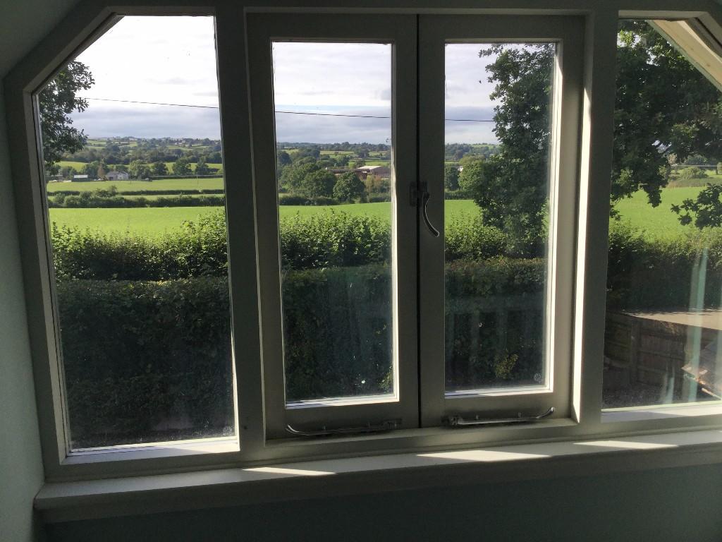 Window facing hills
