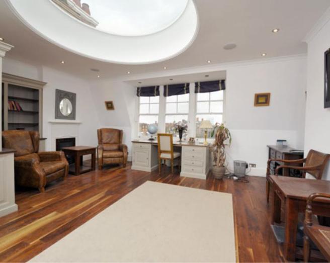 photo of polished beige white aged leather with flooring port hole skylight wood flooring