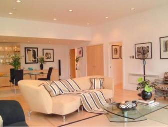 photo of open plan cream living room with fan throw