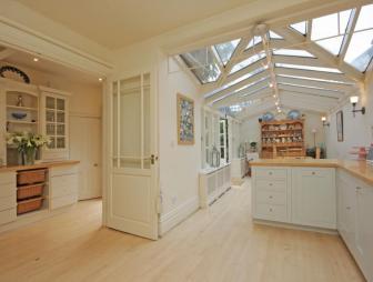 photo of airy beige extension kitchen kitchen extension