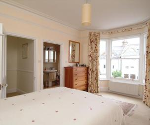photo of beige white bedroom ensuite with bay window