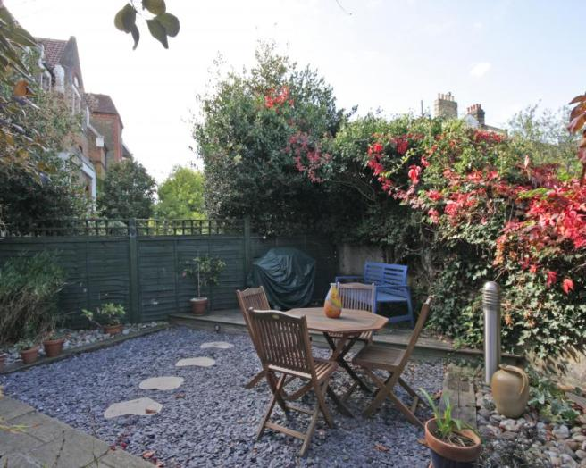 photo of low maintenance gravel garden and outdoor furniture