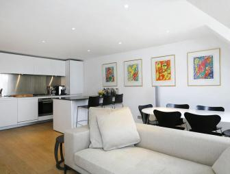 photo of open plan white living room with artwork
