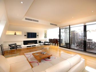 photo of contemporary modern open plan beige white living room sitting room with flooring sliding doors patio doors wooden floor