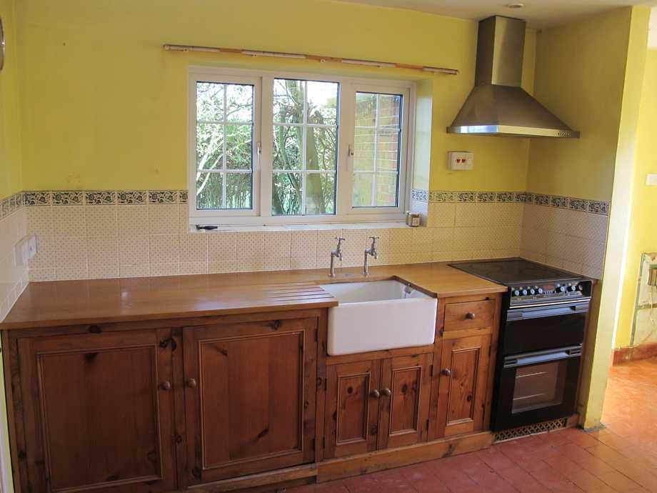 Yellow kitchen design ideas photos inspiration for Brown and orange kitchen ideas