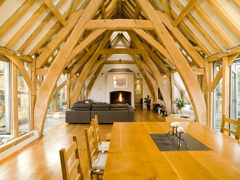 photo of barn conversion open plan beige orange living room lounge with french doors exposed beams patio doors