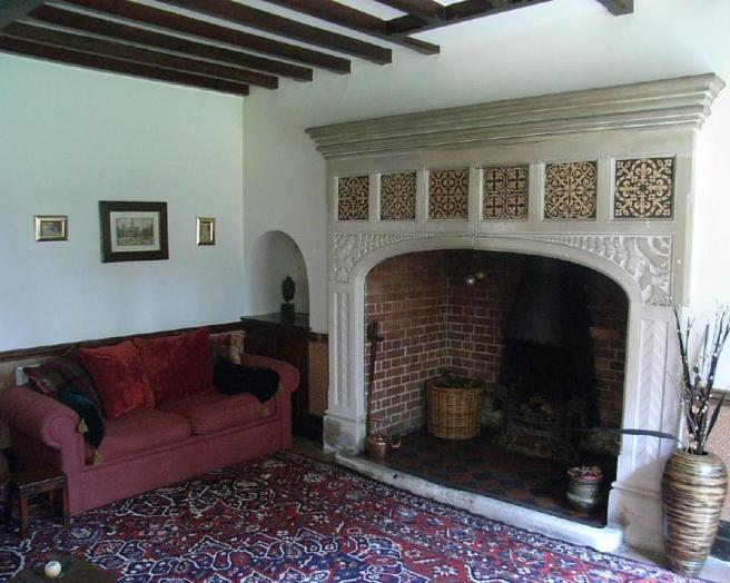 photo of grand homely black blue white drawing room with inglenook fireplace