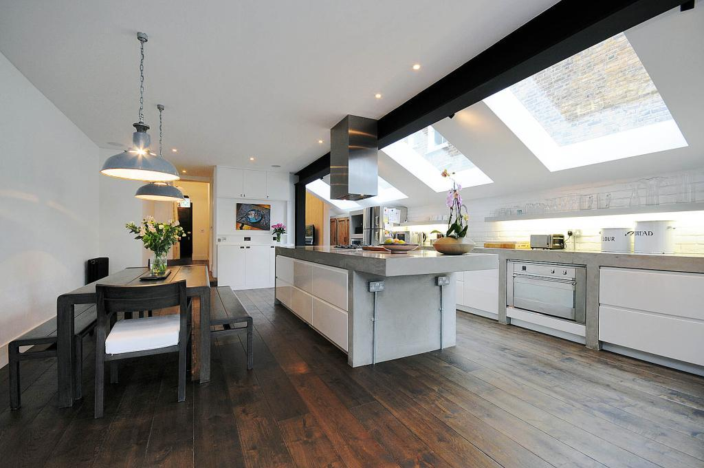 photo of contemporary open plan black white polished concrete kitchen kitchen extension with lighting hardwood floor