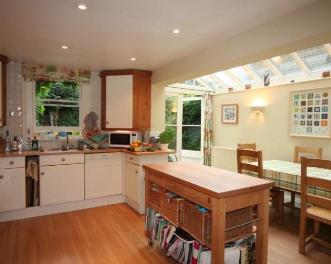 photo of beige brown kitchen extension with laminate floor