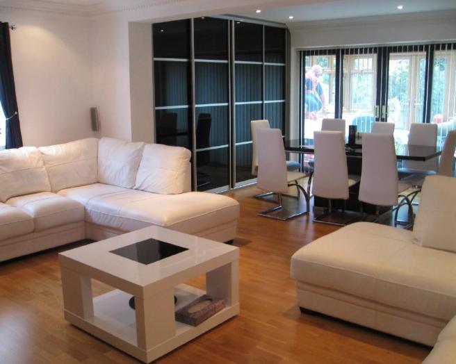 photo of open plan beige black white living room lounge