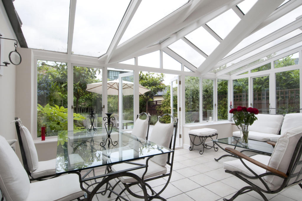 Stunning extended conservatory opening onto the beautiful landscaped garden