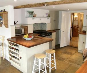 photo of chunky farmhouse rustic white flagstones kitchen and furniture wine rack