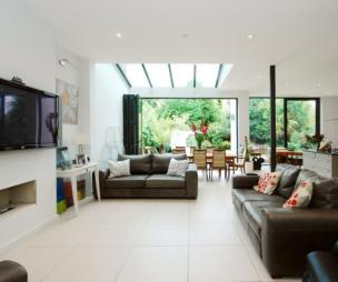 photo of open plan white dining area extension living room lounge with glass roof