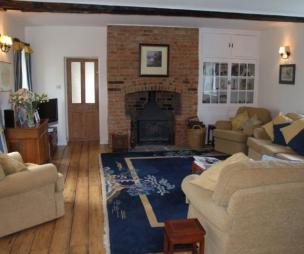 photo of beige blue brown white with beams brick fireplace fireplace floorboards