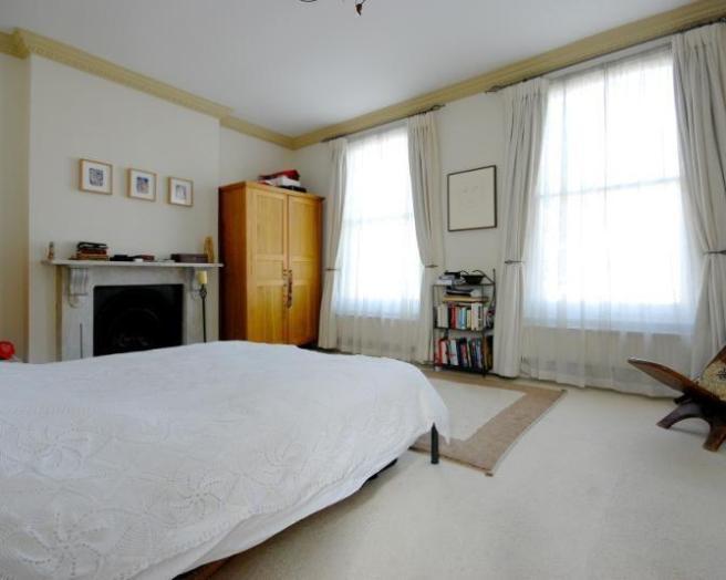 photo of light magnolia white bedroom with lighting fireplace windows carpet rug rugs