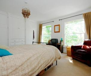 photo of beige white bedroom with carpet and fitted wardrobe furniture