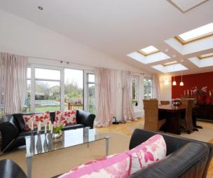 photo of open plan beige pink white dining area living room with velux windows windows