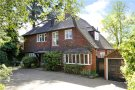 Detached home in Home Park Road, London...