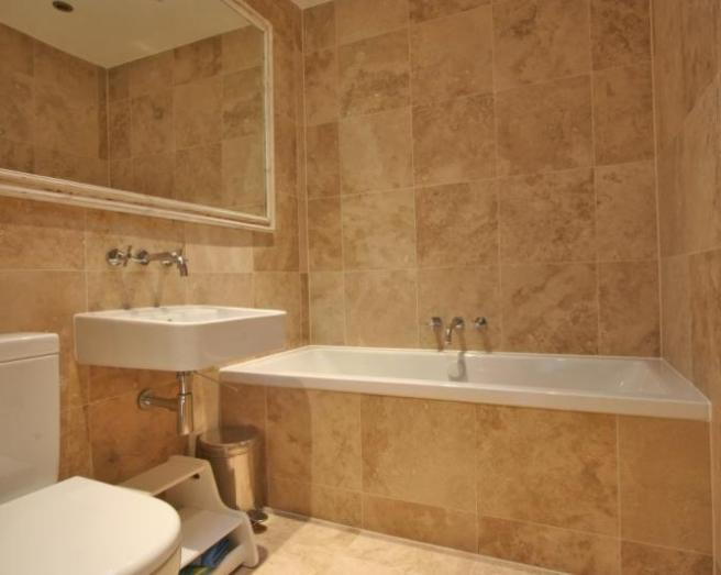 of modern beige brown orange bathroom with mirror mirrors tiled tiles