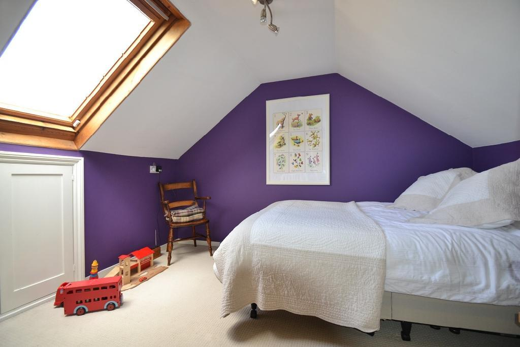 photo of beige purple white velux bedroom loft conversion with storage