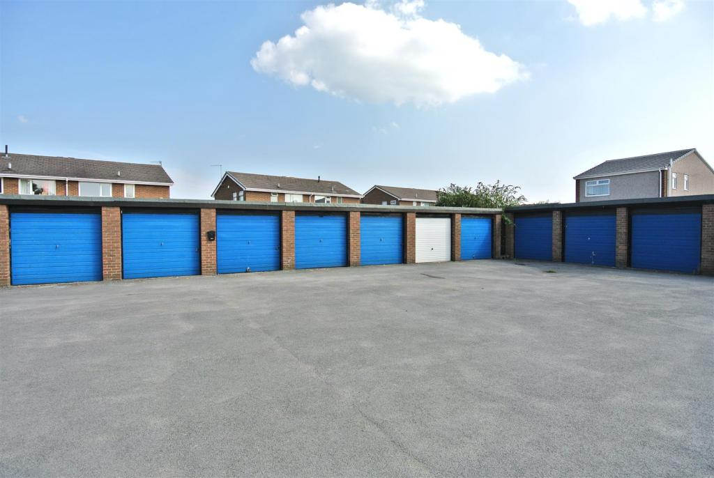 The garages to the r