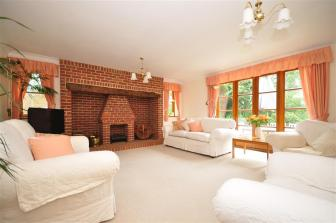 photo of bright white lounge with inglenook fireplace