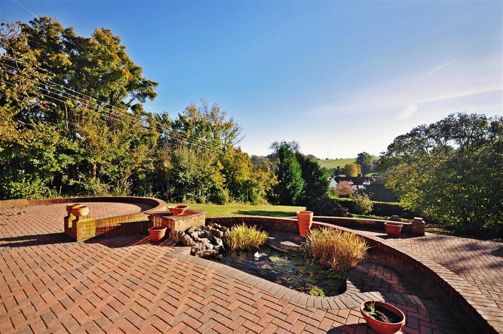 photo of split level brick curved garden and front garden patio terrace water feature
