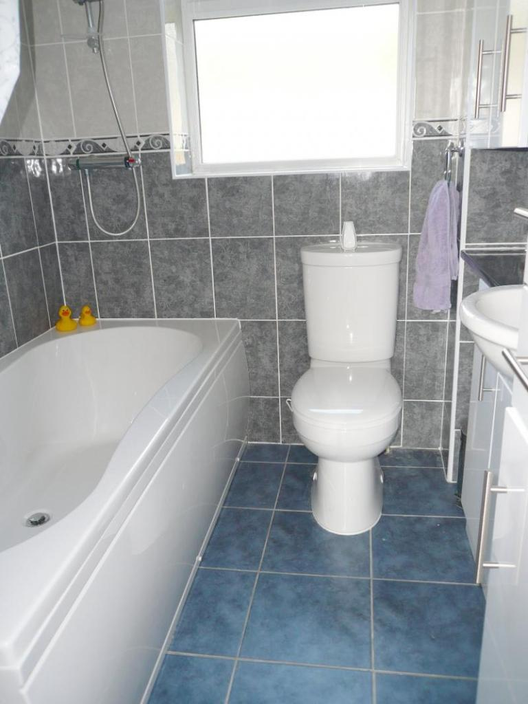 The fully-tiled Bathroom