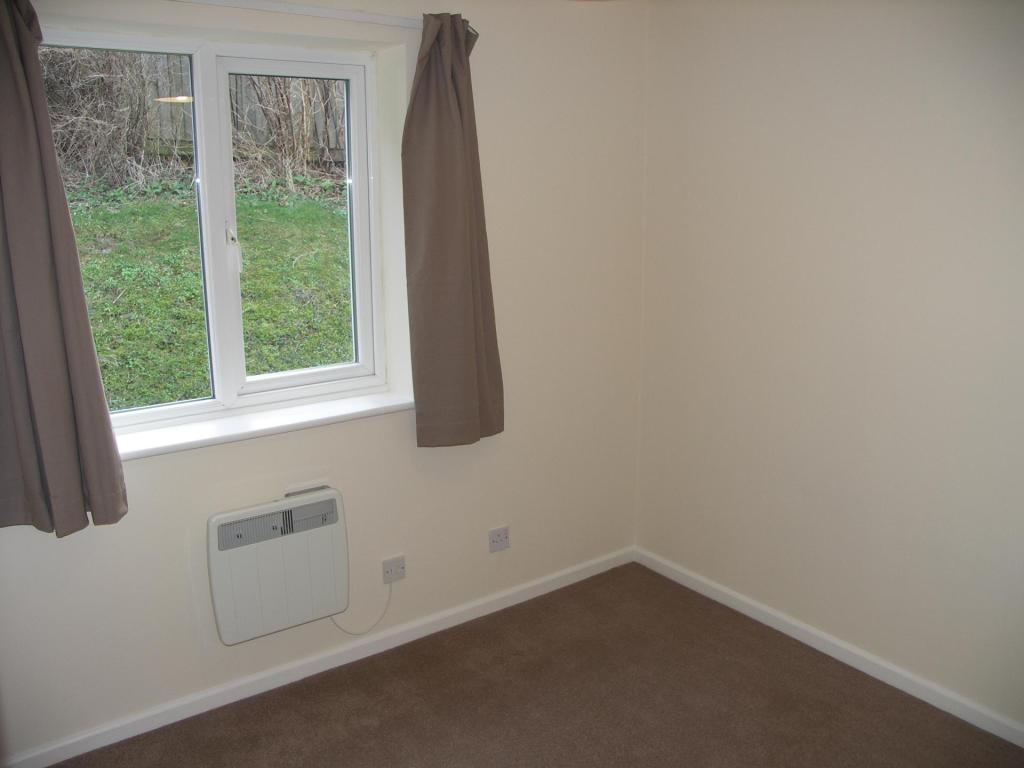 Double bedroom with rear aspect