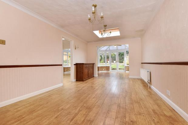 Dining area through to conservatory
