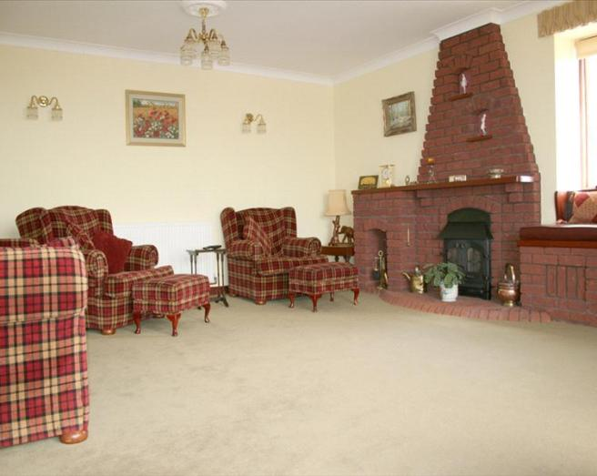 photo of beige brown with brick fireplace fireplace