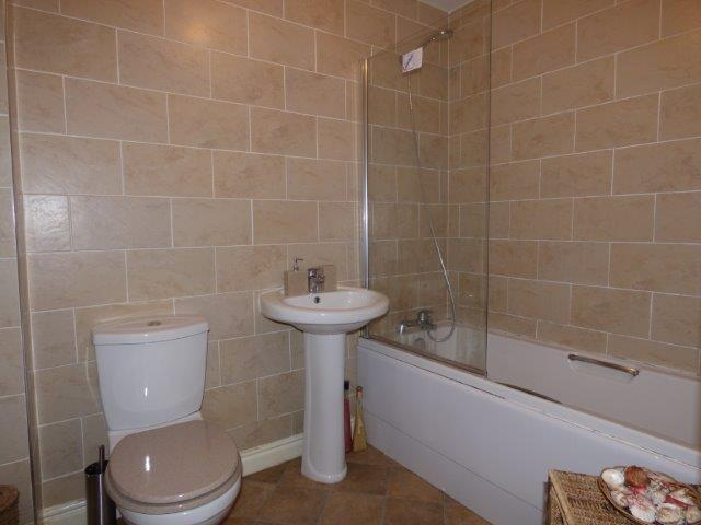 Modern fully tiled bathroom