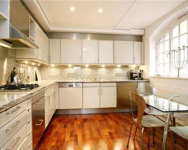 flooring granite counter white kitchen cabinets worktop oak flooring