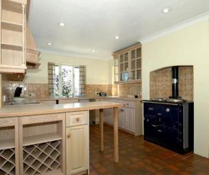 photo of blue dark blue navy blue white kitchen and aga furniture wine rack