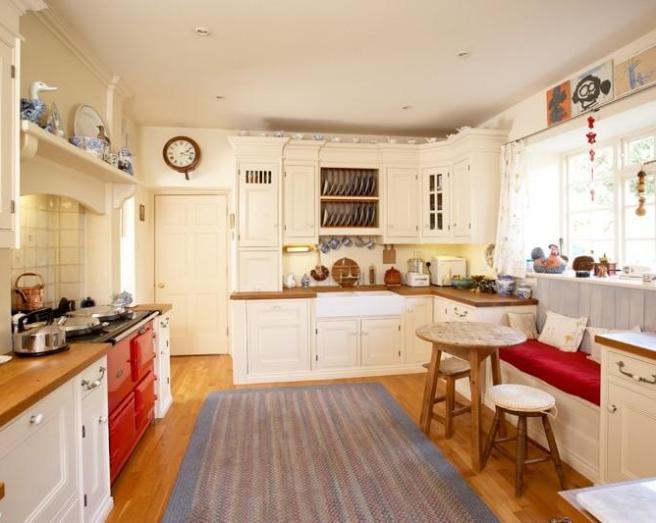photo of red kitchen with belfast sink kitchen bench wooden worktop