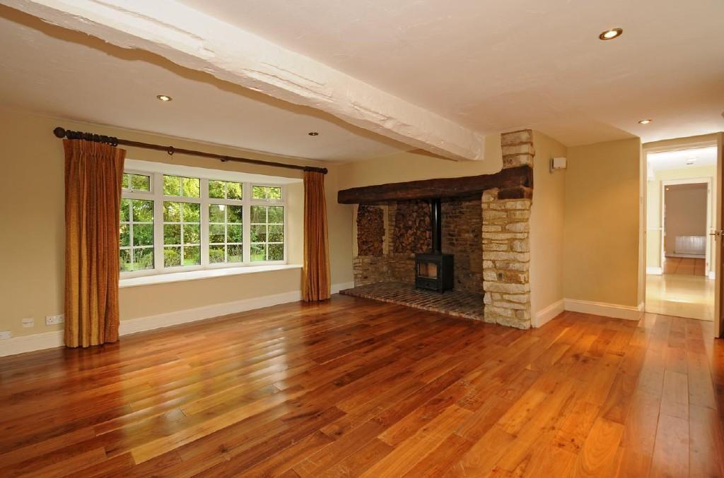 photo of lounge with fireplace floorboards inglenook fireplace varnished floorboards wood burner