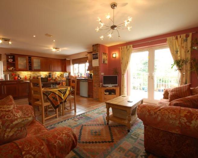 Open plan beige orange design ideas photos inspiration - Red orange and brown living rooms ...