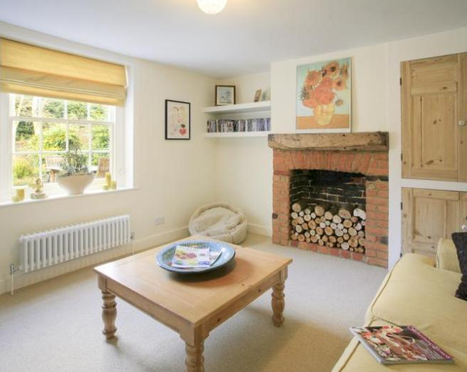 photo of beige white with brick fireplace fireplace
