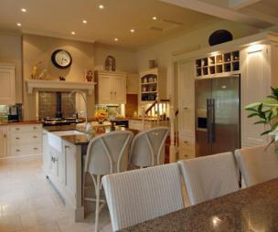 photo of beige brown orange kitchen with island and aga fridge furniture wine rack