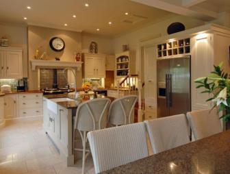 photo of beige brown orange kitchen with island and aga fridge furniture wine rack