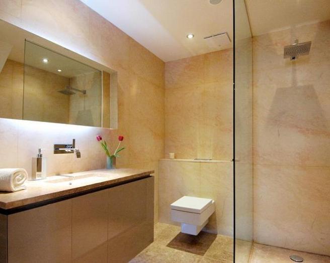 Bath mirror bathroom design ideas photos inspiration for Orange and brown bathroom ideas