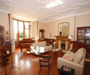 photo of classic living room lounge music room with flooring bay window wooden floor and furniture leather sofa sofa