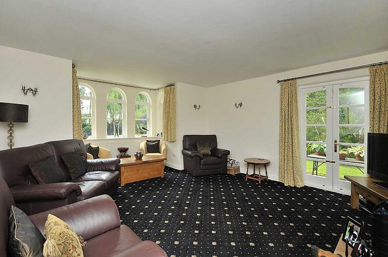 photo of bold black cream white living room lounge with carpet pattern