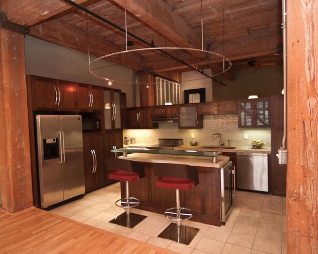 Designer kitchen design ideas photos inspiration for Orange and brown kitchen decor