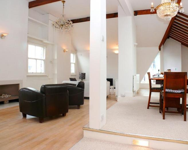 photo of contemporary fittings open plan beige white living room with high ceilings laminate floor