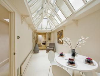 photo of traditional urban vintage beige white conservatory dining room orangery