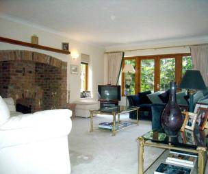 photo of white lounge with french doors wall lights fireplace inglenook fireplace